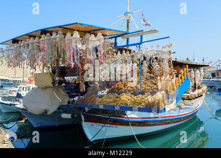 RHODES, GREECE - AUGUST 2017: Souvenir shop organized on traditional Greek wooden boat at port of Rhodes town. - Stock Photo