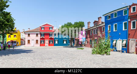 Panorama of brightly colored  houses in  Burano, Venice, Italy around a quiet square, Corte della Comare, with a - Stock Photo