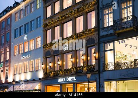 Germany, Bavaria, Munich, Theatiner Strasse shopping district, evening - Stock Photo