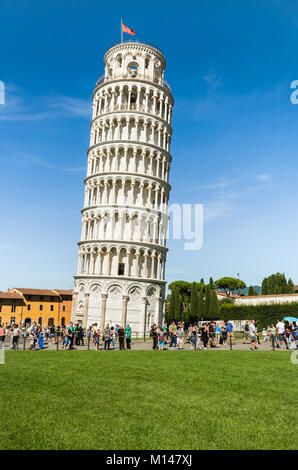 Pisa, Italy - August 17, 2014: The Leaning Tower of Pisa in the Square of Miracles (Piazza dei Miracoli). - Stock Photo