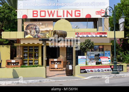 FALIRAKI, GREECE - AUGUST 2017: Wine shop with vintage lamp post on Rhodes island, Greece - Stock Photo