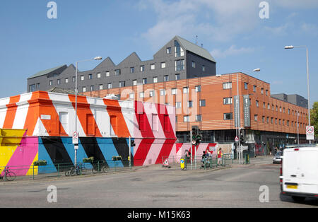 Group of empty houses painted in broad diagonal stripes of red, white and orange paint, massive new block of student - Stock Photo
