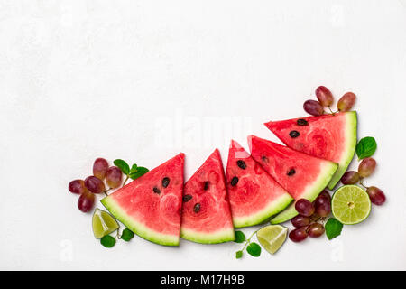 Fresh watermelon and fruits on white background. - Stock Photo