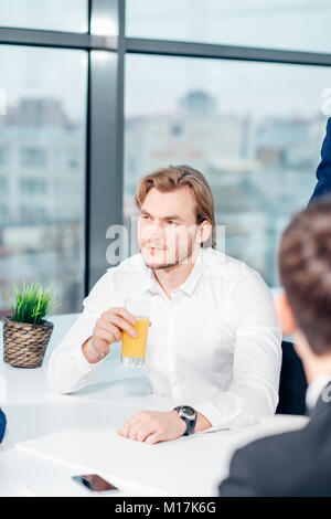 businessman sitting at business meeting - Stock Photo