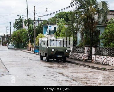Holguin, Cuba - August 31, 2017: Retro looking hunters green van parked on the side of a street. - Stock Photo