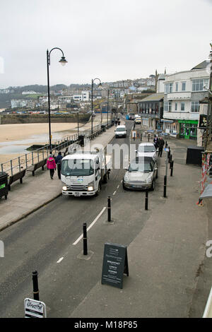 St Ives Cornwall England, January 8th 2018, A view of the harbour and Wharf Road - Stock Photo