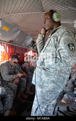 150212-Z-YY327-016 The Fairfield-based 49th Military Police Brigade communications team of Staff Sgt. Darnell Sanders, - Stock Photo