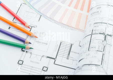 architects workplace - architectural drawings of the modern house with color pencils and sample colors. decoration - Stock Photo