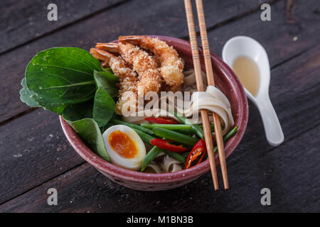 Tempura shrimps with asian noodle soup in a bowl - Stock Photo