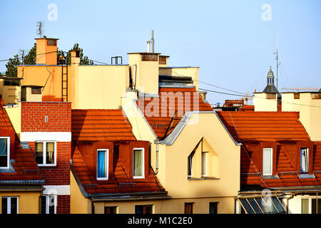 Beautiful houses in Wroclaw with red roofs in morning sun light - Stock Photo