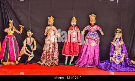 Rajasthani puppet dolls at Nahargarh Fort Jaipur. Puppet show in Rajasthan is a popular tourist attraction. - Stock Photo