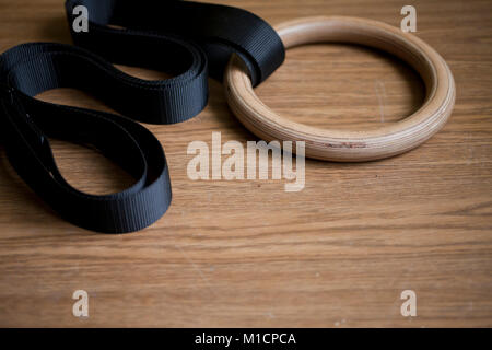 Sport equipment on the floor- gymnastic rings - Stock Photo