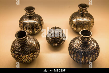 Rajasthan handicraft pottery made of brass and copper with intricate Rajasthani artwork. - Stock Photo