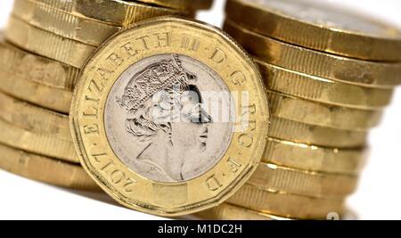 New one pound coins - Stock Photo