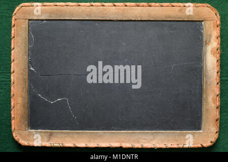 Old vintage school blackboard, made of real slate and bordered with cord - Stock Photo