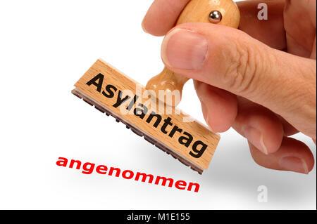 Asylantrag angenommen - markiert auf Holzstempel - Stock Photo