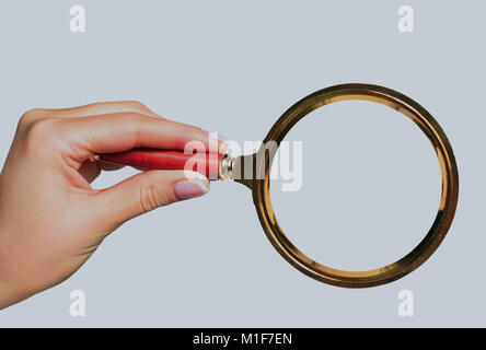 Magnifying glass in hand isolated on white background. - Stock Photo