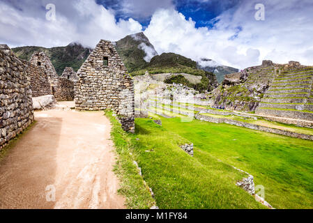 Machu Picchu, Cusco, Peru - Ruins of Inca Empire city and Machupicchu Mountain, Sacred Valley. Amazing world wonder - Stock Photo