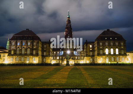 Christiansborg Palace in central Copenhagen at night. Cristiansborg castle in Denmark. Night lights and shadows - Stock Photo