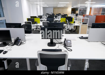 Workstation in an empty open plan office - Stock Photo