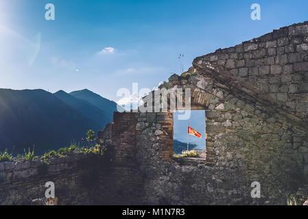 Montenegro Flag on Kotor Fortress - Stock Photo