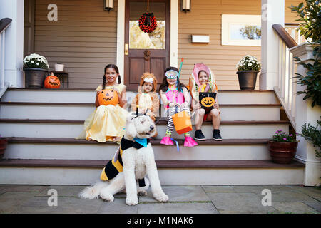 Children And Dog In Halloween Costumes For Trick Or Treating - Stock Photo