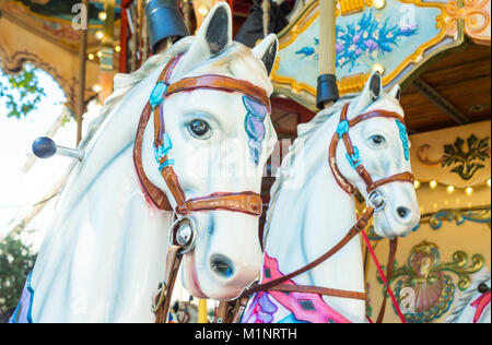 Avignon, France, The colorful wooden horses of a children's carousel in the main square of the country - Stock Photo