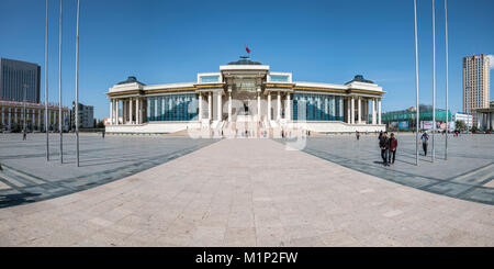 Tourists in Sukhbaatar square with Government palace, Ulan Bator, Mongolia, Central Asia, Asia - Stock Photo