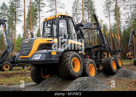 JAMSA, FINLAND - AUGUST 30, 2014: Ponsse presents a smooth ride over a rough terrain with Buffalo Forwarder in a - Stock Photo