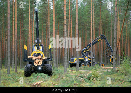 JAMSA, FINLAND - AUGUST 30, 2014: Ponsse forwarder Buffalo and harvester Scorpion in a work demo. Ponsse presents - Stock Photo