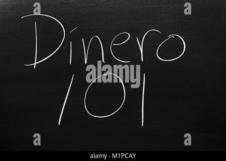 The words Dinero 101 on a blackboard in chalk - Stock Photo