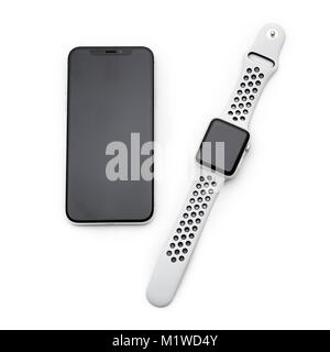 KYIV, UKRAINE - 26 JANUARY, 2018: New Iphone X smartphone model and apple watch close up. Newest Apple devices on - Stock Photo