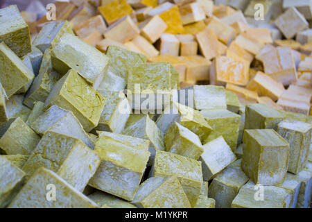 columns and rows of various colorful homemade bar soaps - Stock Photo