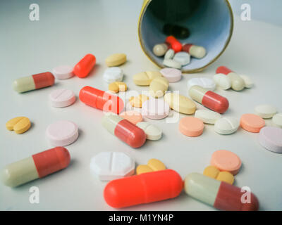 Medication white and colorful tablets arranged abstract on white color background. capsule pills for design. Health, - Stock Photo