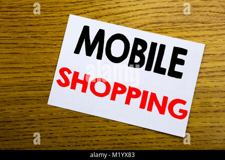 Mobile Shopping. Business concept for Cellphone online order written on sticky note, wooden background with copy - Stock Photo