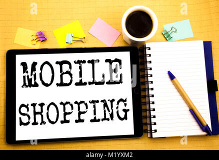 Mobile Shopping. Business concept for Cellphone online order Written on tablet, wooden background with sticky note - Stock Photo