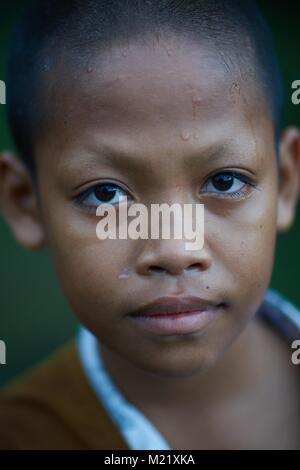 young Monk assistant, Angkor, Cambodia - Stock Photo