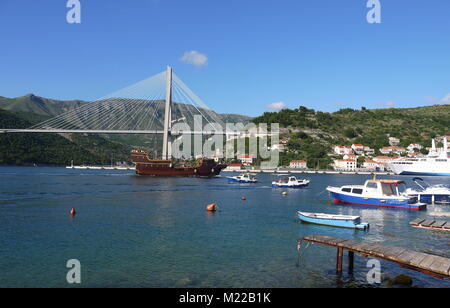 The Franjo Tudjman bridge and blue lagoon with boats and ships in harbor of Dubrovnik, Dalmatia, Croatia, Europe - Stock Photo