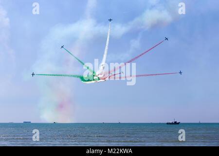 Frecce Tricolori (Tricolour Arrows) - Italian acrobatic aircraft team exhibition over Grado beach, Italy - Stock Photo