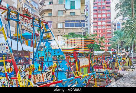 ALEXANDRIA, EGYPT - DECEMBER 17, 2017: The retro fun rides for little children in luna park of Anfoushi neighborhood, - Stock Photo
