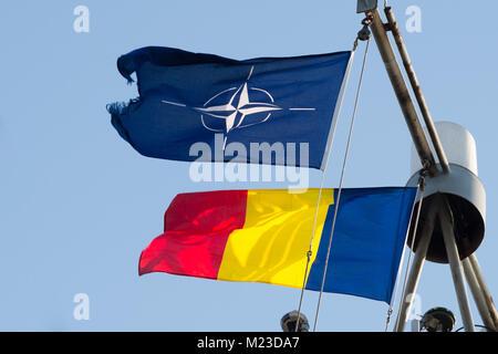 CONSTANTA, Romania, Feb 1. 2018.  Romanian and NATO flags wave in the wind as Standing NATO Mine Countermeasure - Stock Photo