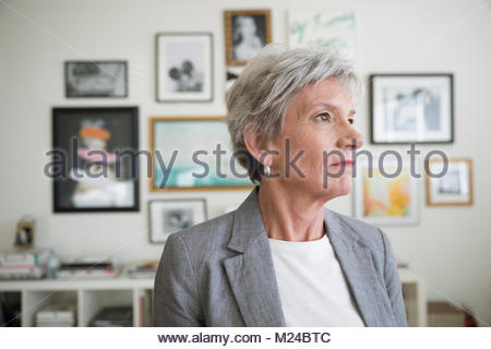 Thoughtful, forward looking businesswoman - Stock Photo