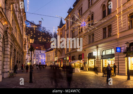 Sritar street with Ljubljana Castle in the background adorned with Christmas lights, Ljubljana, Slovenia - Stock Photo