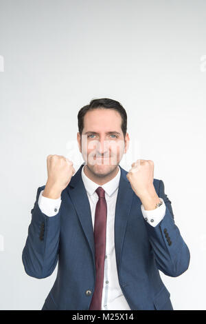 Excited well dressed man punches the air looking happy and excited- isolated on a white background. He is fair skinned - Stock Photo