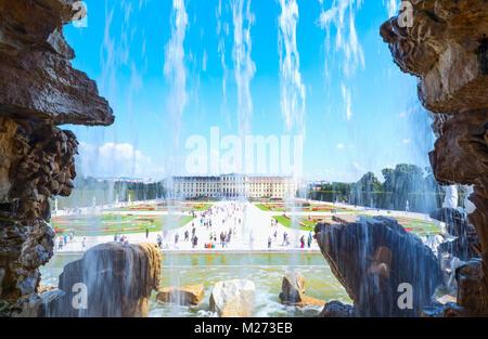 Austria, Vienna,  The garden and the rear facade of the Schonbrunn Palace seen from the Neptune fountain - Stock Photo