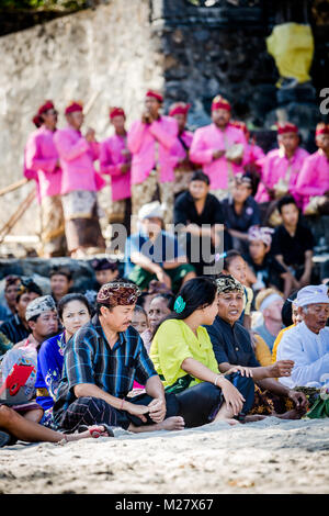 Bali, August 30, 2013: Sea funeral ceremony at Bias Tugel Beach in Bali - Stock Photo