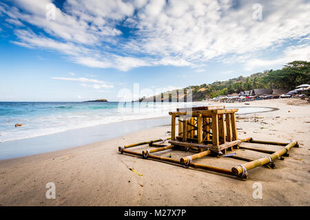 Bali, August 30, 2013: Sea funeral ceremony at Bias Tugel Beach in Bali - the coffin and its remains - Stock Photo