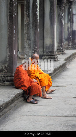 buddhist monks at the ancient temple of angkor wat at siem reap cambodia - Stock Photo