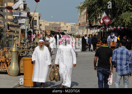 SOUQ WAQIF, DOHA, QATAR -  JANUARY 9, 2018: Shoppers take advantage of fine winter weather in Doha's traditional - Stock Photo