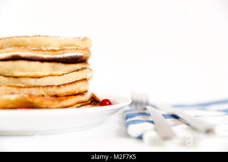 Stack of pancakes with berries and sugar - Stock Photo